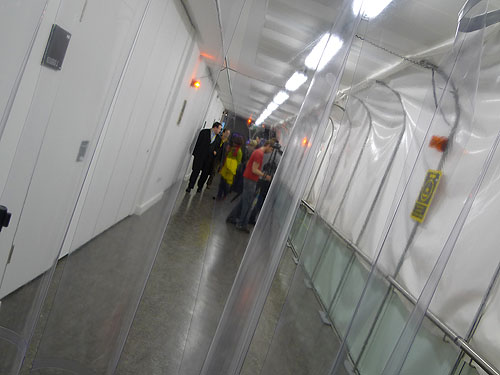 The tunnel contains alarm effects triggered by sentinel tags and disinfection stations.