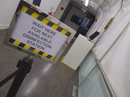 Nearing the end of the tunnel with the disinfection stations.