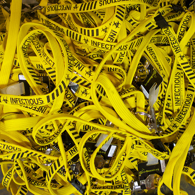 Photo closeup of a bunch of bright yellow lanyards with SocioPatterns badges as used during the INFECTIOUS exhibition in the Science Gallery, spring 2009, Trinity College, Dublin.
